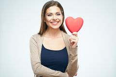Beautiful woman hold red heart. Valentine day love concept. Isolated portrait on white background. Smile with teeth stock photo