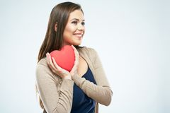 Beautiful woman hold red heart. Valentine day love concept. Studio isolated portrait of smiling woman with long hair. Young model stock images
