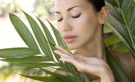 Beautiful woman holding aloe vera gel, skin care and wellness. F Royalty Free Stock Photography