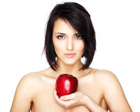 Beautiful woman holding an apple. Beautiful naked woman holding an apple isolated on white Royalty Free Stock Photo