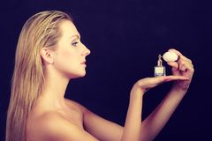 Beautiful woman with holding and applying perfume Royalty Free Stock Images