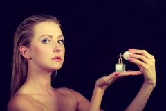 Beautiful woman with holding and applying perfume Stock Photos