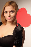 Beautiful woman holding artificial heart. Woman holds big red heart love symbol Royalty Free Stock Photos