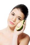 Beautiful woman holding avocado. Stock Photography