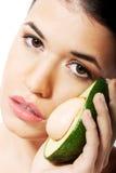 Beautiful woman holding avocado. Stock Image