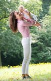 Beautiful woman holding baby in park Stock Images