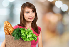 Beautiful woman holding a bag of groceries Stock Images
