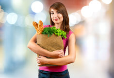 Beautiful woman holding a bag of groceries Stock Photography