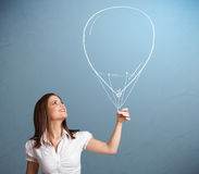 Beautiful woman holding balloon drawing Stock Image