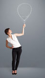 Beautiful woman holding balloon drawing. Beautiful young woman holding balloon drawing Royalty Free Stock Images