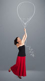 Beautiful woman holding balloon drawing Stock Photography