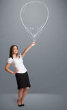 Beautiful woman holding balloon drawing Stock Photo