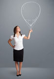 Beautiful woman holding balloon drawing Royalty Free Stock Photo