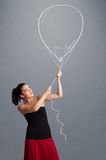 Beautiful woman holding balloon drawing Royalty Free Stock Images