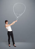 Beautiful woman holding balloon drawing Royalty Free Stock Photo