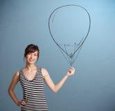 Beautiful woman holding balloon drawing Royalty Free Stock Image