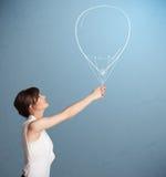 Beautiful woman holding balloon drawing. Beautiful young woman holding balloon drawing Stock Photography