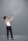 Beautiful woman holding balloon drawing Royalty Free Stock Image