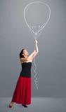 Beautiful woman holding balloon drawing Stock Image