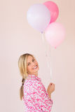 Beautiful Woman Holding Balloons Against Colored Background Royalty Free Stock Image