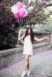 Beautiful woman holding balloons outdoors. Romantic Royalty Free Stock Photo
