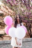 Beautiful woman holding balloons outdoors. Romantic Stock Image