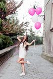 Beautiful woman holding balloons outdoors. Romantic Royalty Free Stock Image