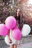 Beautiful woman holding balloons outdoors. Romantic Stock Photography