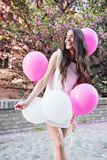 Beautiful woman holding balloons outdoors. Romantic Royalty Free Stock Images