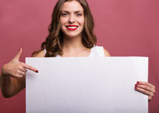 Beautiful woman holding a banner Stock Images