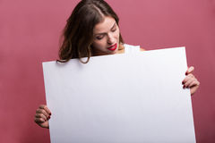 Beautiful woman holding a banner Stock Image