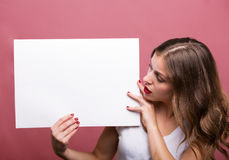Beautiful woman holding a banner Stock Photo