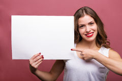Beautiful woman holding a banner Royalty Free Stock Photography