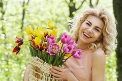 Beautiful woman holding a basket Stock Photography
