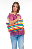Beautiful woman holding beach bag Stock Photo