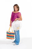Beautiful woman holding beach bag Stock Photography