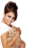 Beautiful woman holding bear Royalty Free Stock Photography