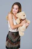 Beautiful woman holding bear toy Stock Photos