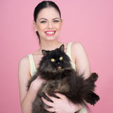 Beautiful woman holding a big black cat Royalty Free Stock Photography