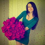 Beautiful woman holding a big bouquet of roses Royalty Free Stock Photos