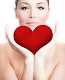 Beautiful woman holding big red heart Stock Images