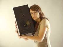 Beautiful woman holding big wooden speaker Stock Images