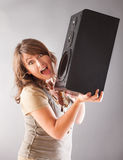 Beautiful woman holding big wooden speaker Royalty Free Stock Images
