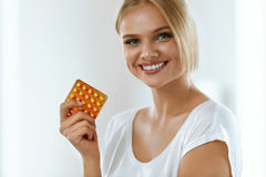 Beautiful Woman Holding Birth Control Pills, Oral Contraceptive Royalty Free Stock Photography