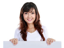 Beautiful woman holding a blank billboard. Royalty Free Stock Images
