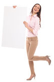 Beautiful woman holding blank board Stock Images