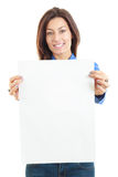 Beautiful woman holding blank board banner smiling. Showing sign on white Stock Photography