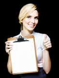Beautiful woman holding blank clipboard Royalty Free Stock Images