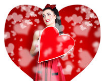 Beautiful woman holding blank love heart sign Stock Images