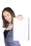 Beautiful woman holding a blank notebook Stock Photography